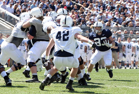 Penn State Nittany Lions running back Cole Chiappialle (33) runs with the ball in the second quarter of the Blue White spring game at Beaver Stadium.