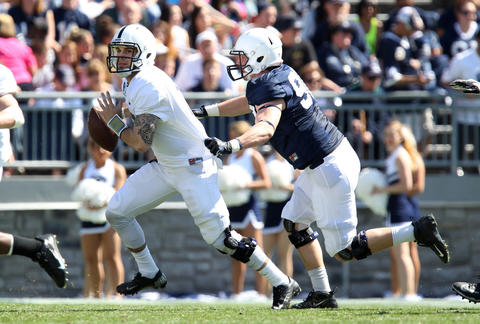 Penn State Nittany Lions defensive end Garrett Sickels (90) sacks Penn State Nittany Lions quarterback D.J. Crook (17) in the third quarter of the Blue White spring game at Beaver Stadium. The Blue team won 37-0.