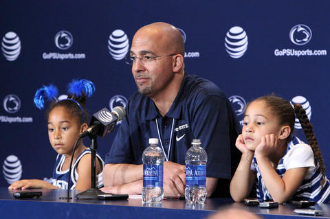 Penn State Nittany Lions head coach James Franklin answers questions from the media as his daughters Shola Franklin (left) and Addison Franklin (right) look on following the completion of the Blue White spring game at Beaver Stadium. The Blue team defeated the White team 37-0.