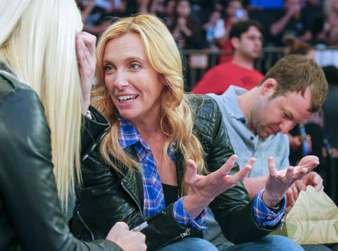 Actress and musician Toni Collette sits courtside at at Madison Square Garden.