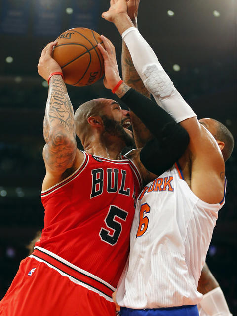 Carlos Boozer drives to the basket during the first half against the Knicks' Tyson Chandler at Madison Square Garden.