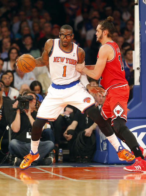 The Knicks' Amar'e Stoudemire works against Joakim Noah during the first half.