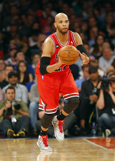 Taj Gibson brings the ball up court during the first half against the Knicks.