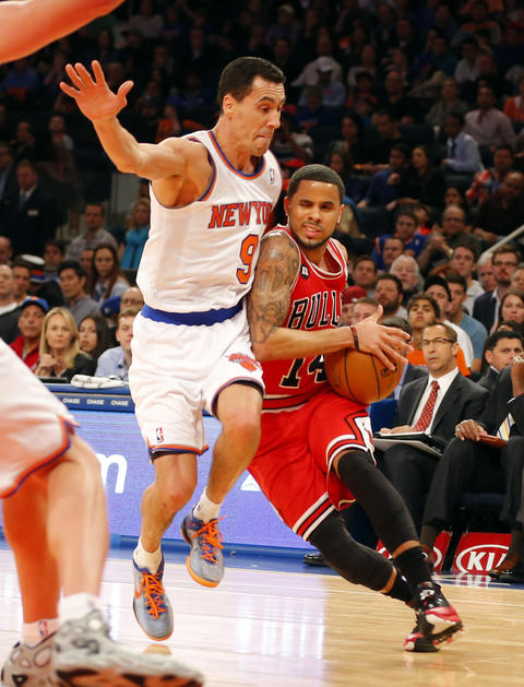 D.J. Augustin drives to the basket during the first half against the Knicks' Pablo Prigioni.