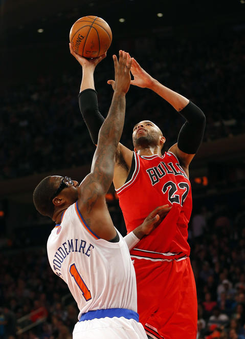 Taj Gibson drives to the basket against the Knicks' Amar'e Stoudemire during the first half.