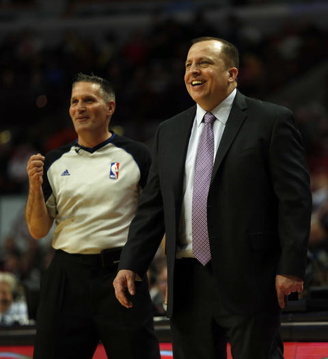 Bulls coach Tom Thibodeau enjoys a light moment with referee Monty McCutchen.