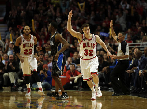 Jimmer Fredette reacts to a three-pointer against the Magic.