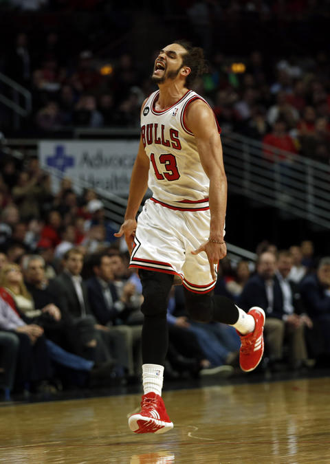 Joakim Noah celebrates one of his 4th quarter baskets against the Magic.