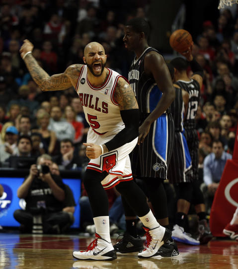 Carlos Boozer celebrates his assist in the 3rd quarter against the Magic.
