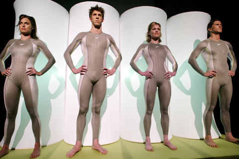 U.S. swimming champions (from left) Amanda Beard, Michael Phelps, Jenny Thompson and Lenny Krayzelburg model new Speedo brand swimsuits at a press conference in New York.