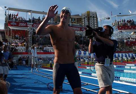 Michael Phelps leaves the pool after breaking the world record in the final of the 400 IM during the Olympic Swim Trials.