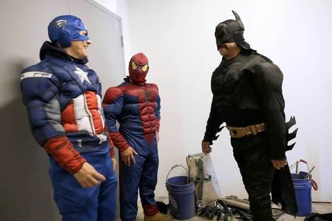 Roberto Duran, left, as Captain America, Gerardo Vaca, center, as Spider-Man and Pedro Castro as Batman are suited up and ready to go.