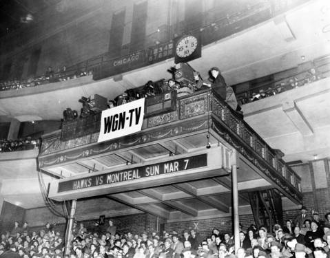 WGN-TV operated from the organ loft at the Chicago Stadium during its first scheduled telecast at the Golden Gloves fights on March 5, 1948.