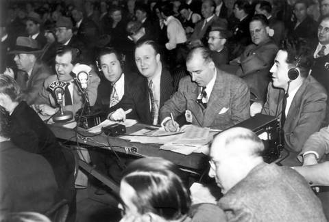 The finals of the Golden Gloves was the first scheduled televised show on WGN-TV with Jack Brickhouse, center at table, as the first voice at the Chicago Stadium on March 5, 1948.