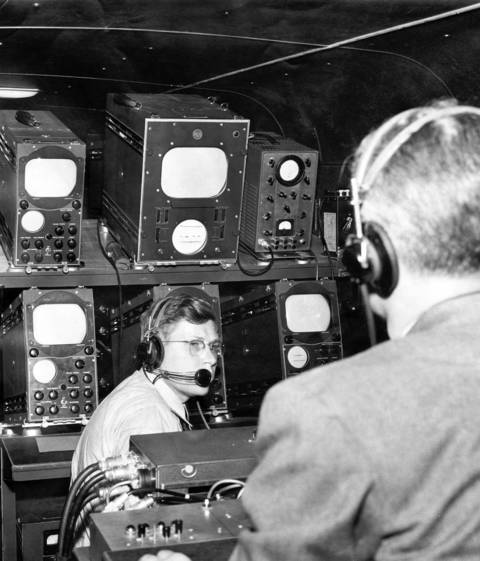Engineers monitor the reception inside WGN's mobile unit at Illinois Street and the WGN building. The unit was put into operation for the opening of WGN-TV on April 4, 1948.