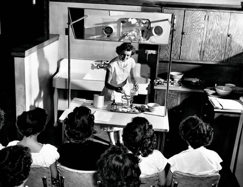 "Flower Vocational High School student Esther Riff practices a cooking demonstration for the WGN-TV program ""Women's Magazine of the Air"", circa Sept. 19, 1951."