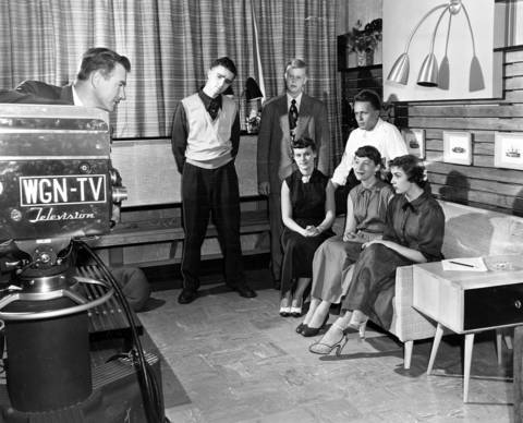 J. E. Faragan, program director for WGN-TV, explains the workings of a television camera to Franklin Weinstein, from left, Glen Swanson, Robin Wright, Al Cohen, Roberta Zells, and Gail Gustafson of the Chicago Public Schools' radio workshop, circa Sept. 19, 1951.