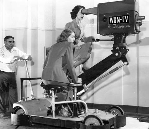 "According to the Tribune, ""Two 'dollies' try out a two-man dolly unit on which the camera can be raised, lowered, and moved,"" circa April 4, 1948."