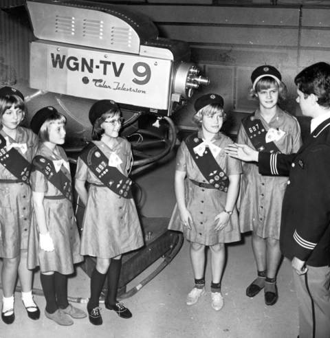 A Girl Scout troop from Palatine learns about the operation of WGN-TV studios during a tour given by guide Frank Kapanowski, circa Nov. 19, 1965.