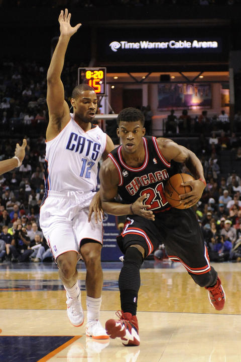 Jimmy Butler drives into the the Bobcats defense of Gary Neal.