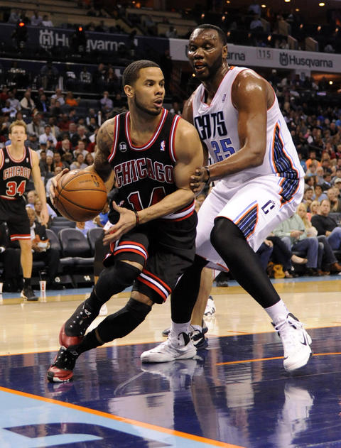 D.J. Augustin drives past the Bobcats' Al Jefferson during the first half.