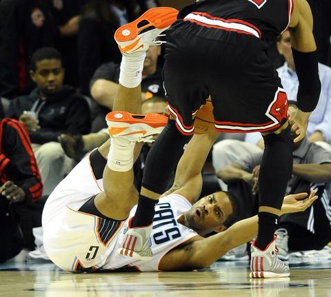 The Bobcats' Gary Neal reaches out for a loose ball.