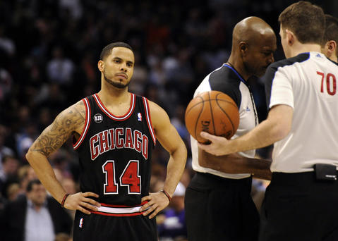 D.J. Augustin looks on as the referees talk during the second half of the game.