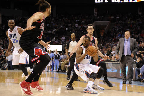 The Bobcats' Kemba Walker looks to pass as he is defended by Joakim Noah and Kirk Hinrich during the second half.