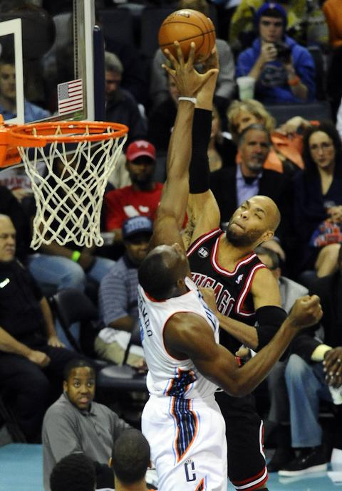 Taj Gibson has his shot blocked by the Bobcats' Bismack Biyombo in the second half.