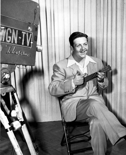 "Ukulele playing disc jockey Eddie Hubbard in a promotional picture for his show ""Catalog Quiz"" on WGN-TV, which premiered on Sept. 12, 1949."