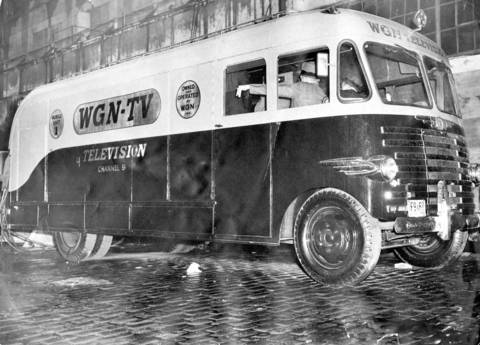 The WGN-TV mobile unit in operation on the street as it rehearsed programs for opening tonight at Illinois Street and the WGN Building on April 4, 1948.