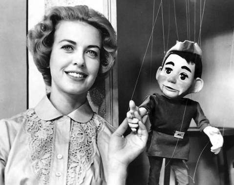 "Mary Jane Dlouhy, seen here in 1961, was the host of the WGN-TV morning children's show ""Treetop House."" Dlouhy hosted the show with Mr. Widgin, a marionette."