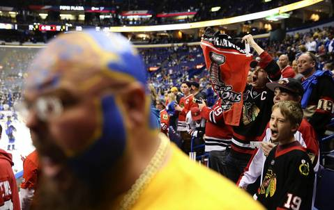 Nick Signore, of O'Fallon, cheers for the Blackhawks during warmups.