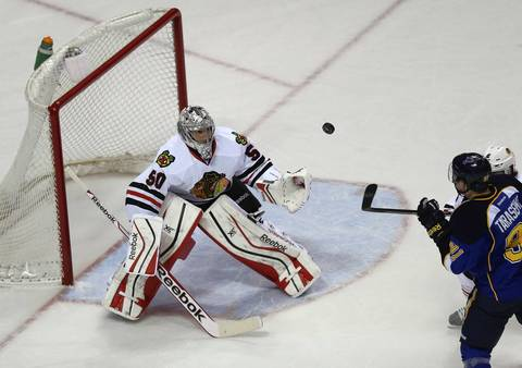Blackhawks goalie Corey Crawford eyes the puck in the first period.