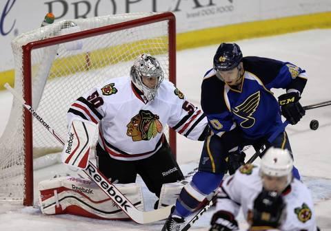 Corey Crawford is unable to stop the puck as the Blues score the first goal on the first period.