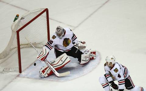 Blackhawks goalie Corey Crawford is unable to stop the puck as the Blues score in the first period.
