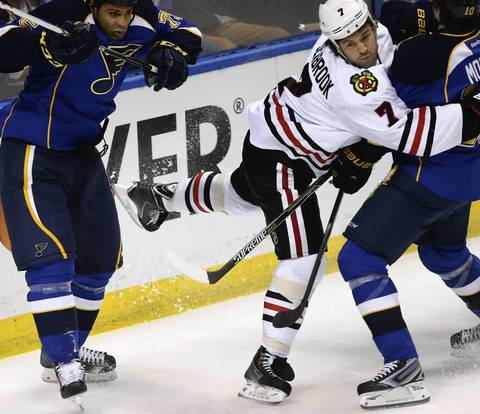 Brent Seabrook gets tangled up in the first period.