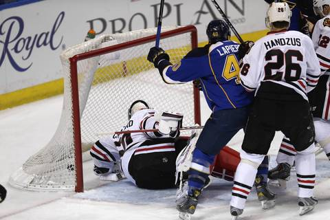 Blackhawks goalie Corey Crawford is unable to stop the Blues from scoring their first goal in the first period.