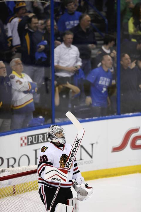 Blackhawks goalie Corey Crawford reacts after giving up the first goal of the first period.