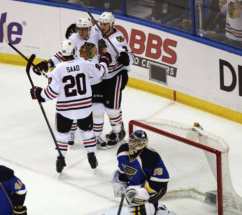 Brandon Saad, Marian Hossa and Brent Seabrook celebrate after Seabrook's first period goal.