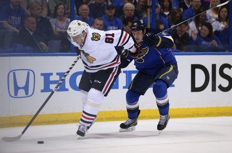 Marian Hossa and the Blues' Jay Bouwmeester battle in the second period.