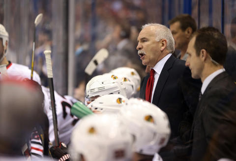 Blackhawks head coach Joel Quenneville gives direction to his players in the second period.