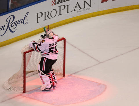 Blackhawks goalie Corey Crawford reacts after allowing a goal that tied the game at 3-3 in the third period.