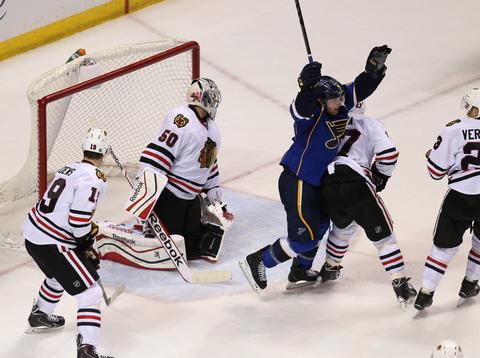 The Blues' Jaden Schwartz celebrates after scoring on goalie Corey Crawford in the third period.