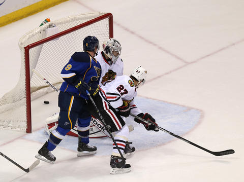 The puck slips by Blackhawks goalie Corey Crawford as the Blues' Jaden Schwartz scores late in the third period.