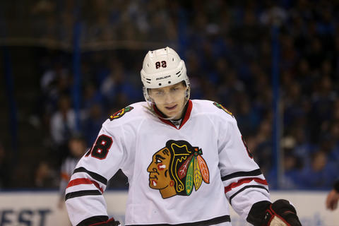 Patrick Kane skates toward the bench during a break in the action in the first overtime.
