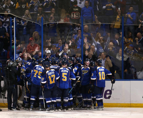 The Blues celebrate after beating the Blackhawks 4-3 in triple overtime.
