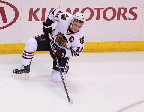 Jonathan Toews reacts after being checked into the boards by the Blues' Ryan Reaves.