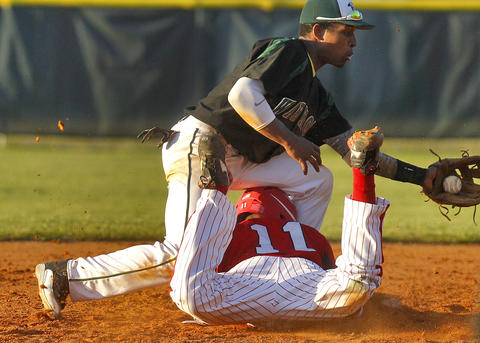 Hampton's Cal Kee, bottom, dives safely back to second base before the the tag from Kecoughtan's Kole Tyson during Tuesday's game at Hampton.