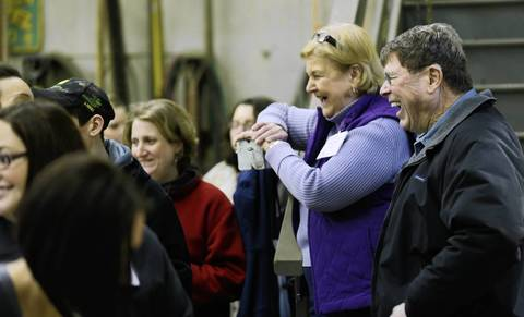 Eldon and Sandy Gould laugh while talking with Field Moms on the tour.